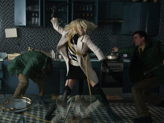 Charlize Theron whups bad guys as an undercover secret agent in 'Atomic Blonde.'