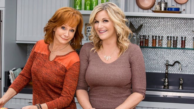 "Reba McEntire joins Trisha Yearwood on the Food Network show ""Trisha's Southern Kitchen."""