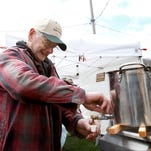 Dale Roloson pours a sample of warm maple syrup that was harvested from the family farm in Troy, Pennsylvania. Roloson is a third generation partner of the Roloson Brothers Maple Syrup.