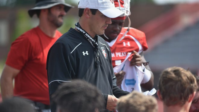 Austin Peay's Will Healy speaks with his players following practice on Aug. 10.
