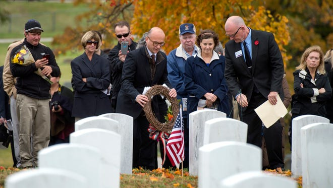 "Consul General of France in Chicago Guillaume Lacroix lays a wreath at the headstone of James Bethel Gresham at the James Bethel Gresham Commemoration at Locust Hill Cemetery in Evansville, Ind., on Friday, Nov. 3, 2017. Gresham was among the first American soldiers to reach the battlefield in France, and one of the first who passed in World War I. Lacroix was presented with an award for an ""honorary Hoosier"" during the ceremony."