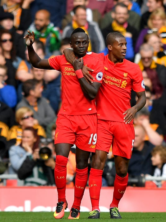 Liverpool's Sadio Mane, left, celebrates scoring his side's third goal of the game during their Premier League match Liverpool versus Hull City at Anfield, Liverpool, England, Saturday Sept. 24, 2016. (Dave Howarth/PA via AP)