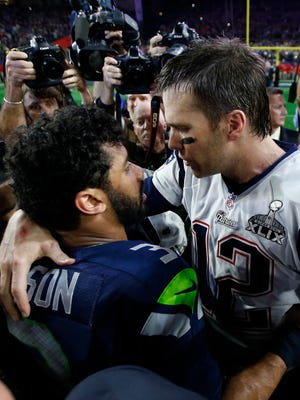 New England Patriots quarterback Tom Brady (12) greets Seattle Seahawks quarterback Russell Wilson (3) after Super Bowl XLIX at University of Phoenix Stadium.