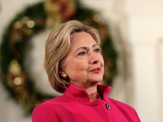 Democratic presidential candidate Hillary Clinton listens