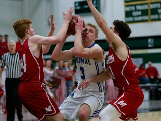 Auburndale's Cale Jacoby(3), middle, gets block by