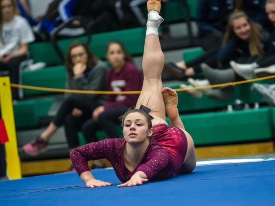 Hillsborough's Sarah Pallay competes in the floor exercise in the NJSIAA Gymnastics state individual championship at Montgomery High School on Saturday Nov. 14, 2015. Photo by Jeff Granit