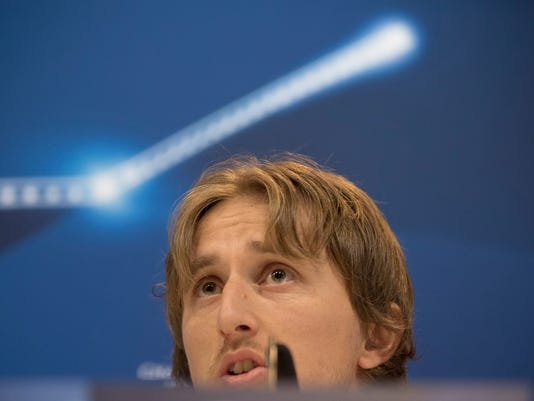 Real Madrid's player Luka Modric speaks during a press conference after a training session at the Valdebebas stadium ahead of Wednesday's Champions League soccer match between Real Madrid and Napoli, in Madrid, Spain, Tuesday, Feb. 14, 2017 . (AP Photo/Daniel Ochoa de Olza)