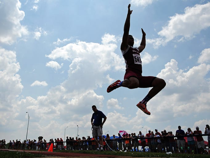 """Roosevelt's Taryn Christion competes in the """"AA"""" Boys Long Jump event during the South Dakota State Track and Field Meet on Friday, May 30, 2014, at McEneaney Field at O'Gorman High School in Sioux Falls."""