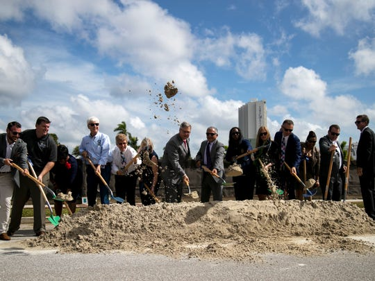 Officials from Lee County, the City of Fort Myers and the Luminary Hotel participate in the ceremonial groundbreaking for the new downtown hotel on Friday, October 6, 2017, in Fort Myers.