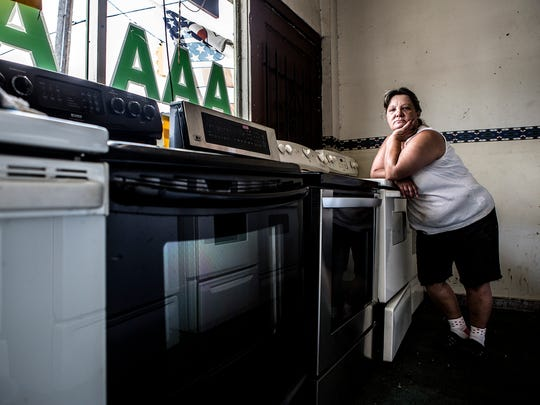 Maggie Diles, 53, has worked in her family's used appliance