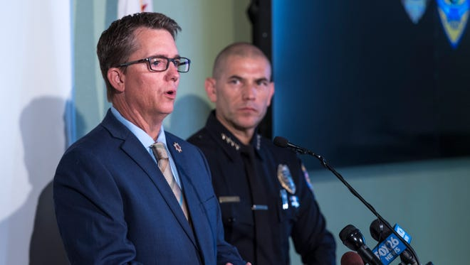 Tulare County District Attorney Tim Ward, left, and Visalia Police Chief Jason Salazar announce murder charges filed Monday, August 13, 2018 in Visalia, Calif. against Joseph James DeAngelo for the shooting of Claude Snelling in 1975. Investigators believe the Visalia murder was the first for the alleged Golden State Killer also known as the Visalia Ransacker. He has already been charged with 12 other murders.
