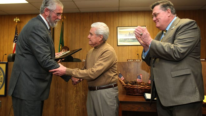 """(left to right) Councilman Albin Wicki makes a presentation to Luigi Guarnieri during Union Beach council meeting with Mayor Paul Smith Jr. Luigi """"Louie"""" Guarnieri was being honored by UB council for his nearly six decades of business in the borough. Lou's Barbershop was destroyed in the fire at Hydrair in June when firefighter Bob """"Hawk"""" Meyer suffered a fatal heart attack. Louie, 76, first worked at the barbershop in 1956 before buying it a few years later. Thursday, January 22, 2015. Union Beach,NJ Noah K. Murray-Special for the Asbury Park Press ASB 0120 union beach barber retires"""