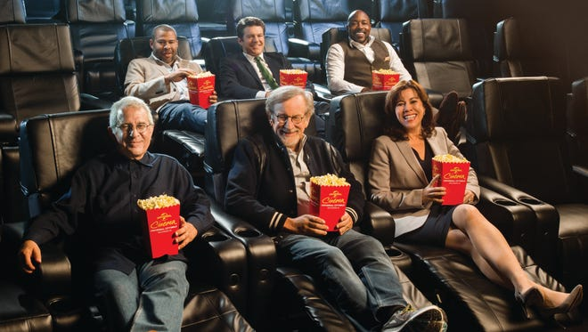 NBCUniversal vice chairman Ron Meyer (front row, from left), filmmaker Steven Spielberg, Universal Studios Hollywood president Karen Irwin, filmmaker Jordan Peele (back from left), producer Jason Blum and filmmaker Will Packer test out the luxury seats at the opening of Universal CityWalk's revamped Universal Cinema.