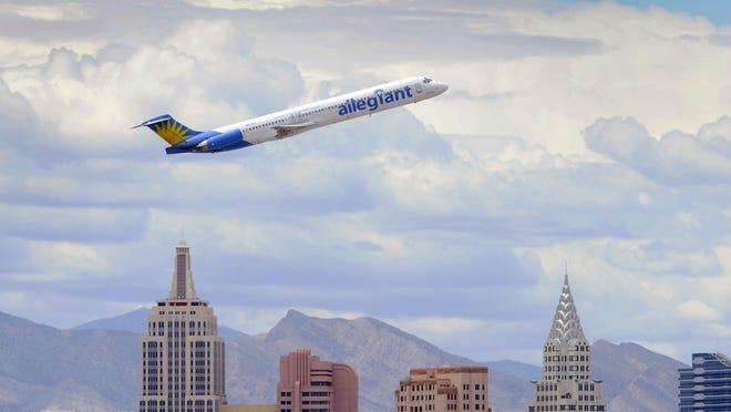 An Allegiant Air jetliner flies over Las Vegas in 2013.