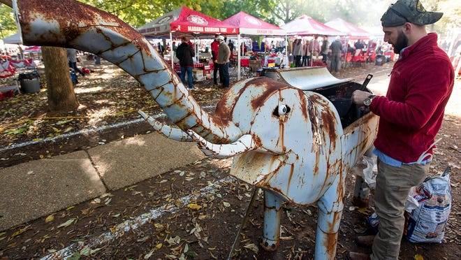 Austin Prince fires up his elephant grill before the Alabama-LSU game last November in Tuscaloosa, Ala. Alabama and Auburn will not allow tailgates, and Mississippi's governor even signed an order banning them.