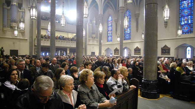 In this Journal Star file photo from 2007, a full house gathers at St. Mary's Cathedral to celebrate the close of the diocesan phase of the path toward sainthood for Archbishop Fulton J. Sheen.