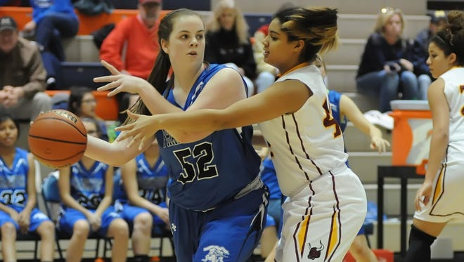 Frankfort's Rylee Seibert is defended by McCutcheon's Bear Wood during Friday night's J&C Hoops Classic at Harrison.