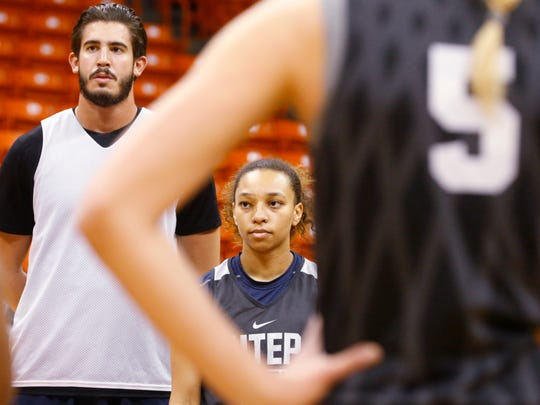 UTEP point guard Faith Cook applies the defensive pressure during basketball practice in the Don Haskins Center Tuesday morning. Cook has worked her way into a starting role on the team after her play during the first part of the current season. Team mate Jordan Jenkins and Cook have been sharing playing time during the past fifteen games of the 2017-18 season.