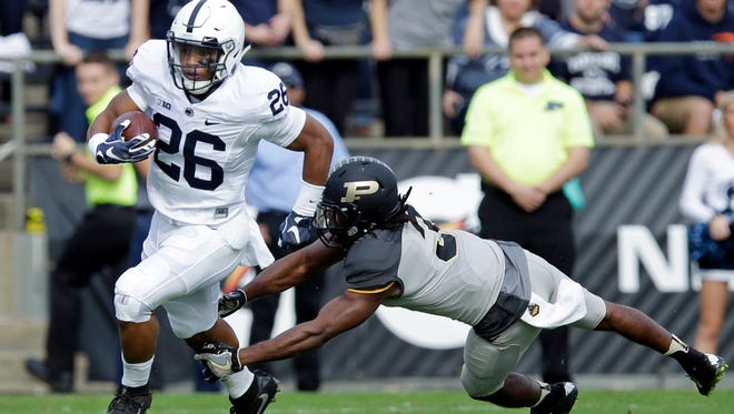 Penn State running back Saquon Barkley (26) breaks the tackle of Purdue safety Leroy Clark (3) during the first half of an NCAA college football game in West Lafayette, Ind., Saturday, Oct. 29, 2016.