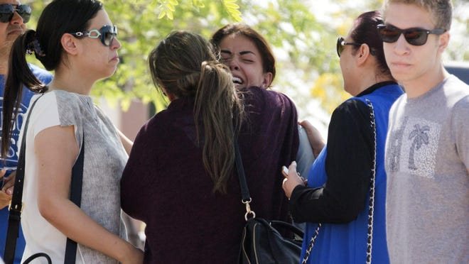 Relatives of passengers on a vanished EgyptAir flight grieve as they leave the in-flight service building where they were held at Cairo International Airport, Egypt, May 19, 2016. Egyptian aviation officials say an EgyptAir flight from Paris to Cairo with 66 passengers and crew on board has crashed.