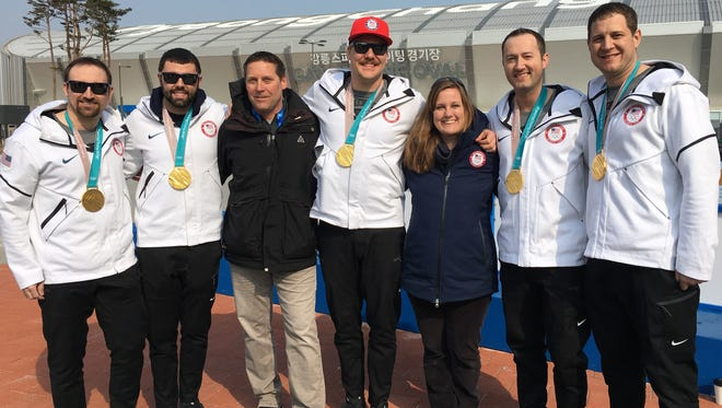 The USA men's curling gold medal contingent at Gangneung Olympic Park in South Korea. From left, Joe Polo, John Landsteiner, USA Curling CEO Rick Patzke, Matt Hamilton, USA Curling Communications Director Terry Davis, Tyler George and team captain John Shuster.