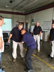 Gary Berry, center, instructs participants in a defensive tactics class.