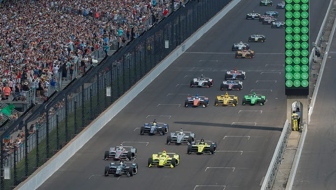 Ed Carpenter Racing IndyCar driver Ed Carpenter (20) leads the group of 33 cars at the start of the102nd running of the Indianapolis 500 at Indianapolis Motor Speedway on Sunday, May 27, 2018.