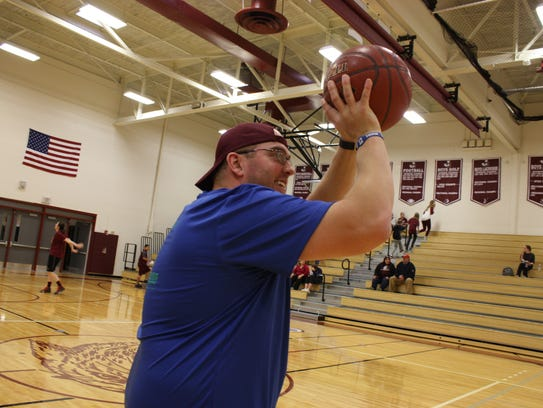 A2A adviser Joe Schieve warms up before the game in