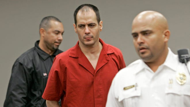 In this Tuesday, Jan. 9, 2007, file photo, death row inmate Juan Carlos Chavez arrives at the courtroom after a recess in Miami.