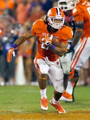 Clemson Tigers running back Zac Brooks (24) runs the ball during the fourth quarter against the Georgia Bulldogs at Clemson Memorial Stadium.