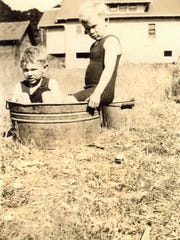 Charles and Robert Lorence, the first kids raised in the house.