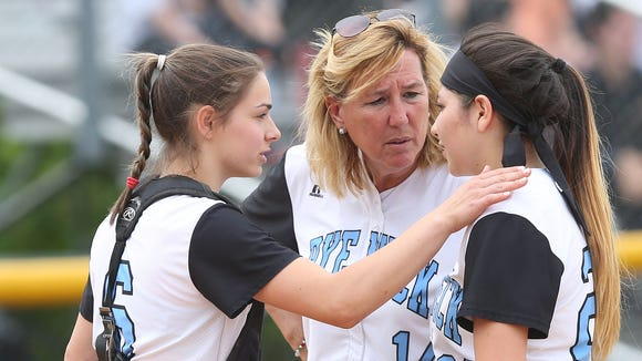 Rye Neck softball coach Joan Spedafino talks to players