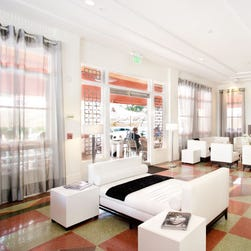 A room at the Room Mate Waldorf in Miami. Room Mate hotels will offer free portable Wi-Fi at all 19 hotels.
