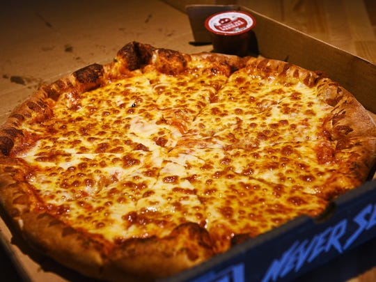 Joe Ahlquist / Argus Leader Toppers Pizza's cheese