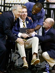 Sean Esmond receives his diploma June 10, 2017, from The Tatnall School more than two years after he and his brother, Ryan, were poisoned and left paralyzed during a stay in a Virgin Islands condo.