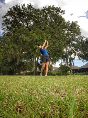 John Paul II golfer Teresa Conroy hits an iron off the tee on Killearn Country Club's North Course during a round last week.