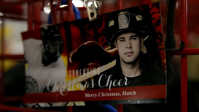 """A photo of Matthew Hutchinson appears on a christmas card he was given by members of the Geneseo Fire Department where he served as a volunteer firefighter. Matthew Hutchinson was one of three people in their early 20s were found dead Sunday morning in an off-campus home near the SUNY Geneseo campus.  The victims were identified as: Kelsey Annese, 21, of Webster, and Matthew Hutchinson, 24, of North Vancouver, British Columbia. The assailant was identified as Colin Kingston, 24, of Geneseo. According to police, Kingston, who had a three-year relationship with Annese , brought a """"large knife"""" to the home and confronted Annese and Hutchinson. The two were found dead with fatal stab wounds. Colin Kingston then turned the knife on himself suffering fatal self inflicted stab wounds."""