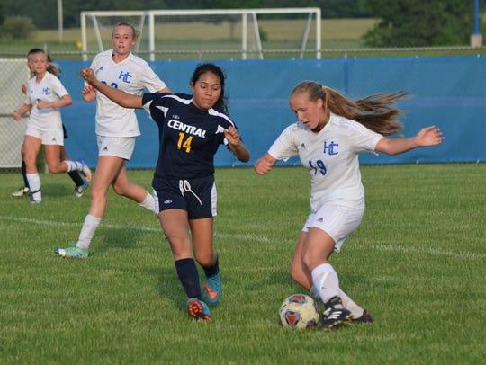Harper Creek's Carinna Baird tries to get past Battle