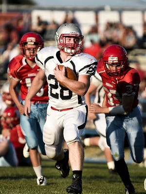 Elgin's Zach Murdock breaks through the Ridgedale defense during a game this season. A company survey shows that high school football is the most popular local sport for fans to follow.