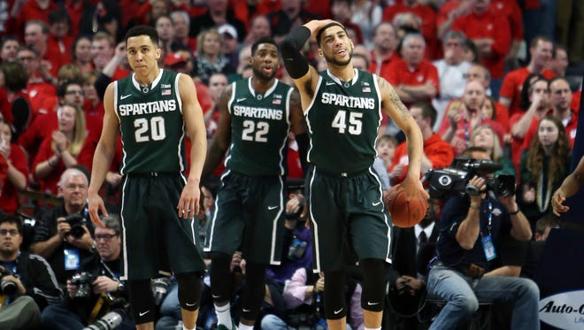 Michigan State's Travis Trice (20) , Branden Dawson (22) and Denzel Valentine (45) react during the second half in the championship game of the Big Ten Tournament against the Wisconsin Badgers at United Center on March 15, 2015.