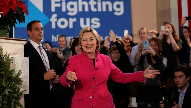 Democratic presidential candidate Hillary Clinton, center, smiles as she arrives at a campaign event Tuesday, Dec. 29, 2015, at South Church, in Portsmouth, N.H.
