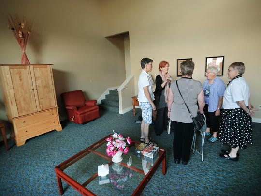 The Threshold Singers of Indianapolis warm up in song as they visit the Abbie Hunt Bryce Home in Indianapolis, one of 11 hospices for the homeless in the country.