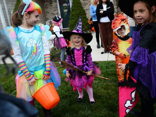 From left riley Siler, Nevaeh Murphy, Dakota Horner and Lillian Rankin gather during trick-or-treat night in Dillsburg Thursday, Oct. 30, 2014.