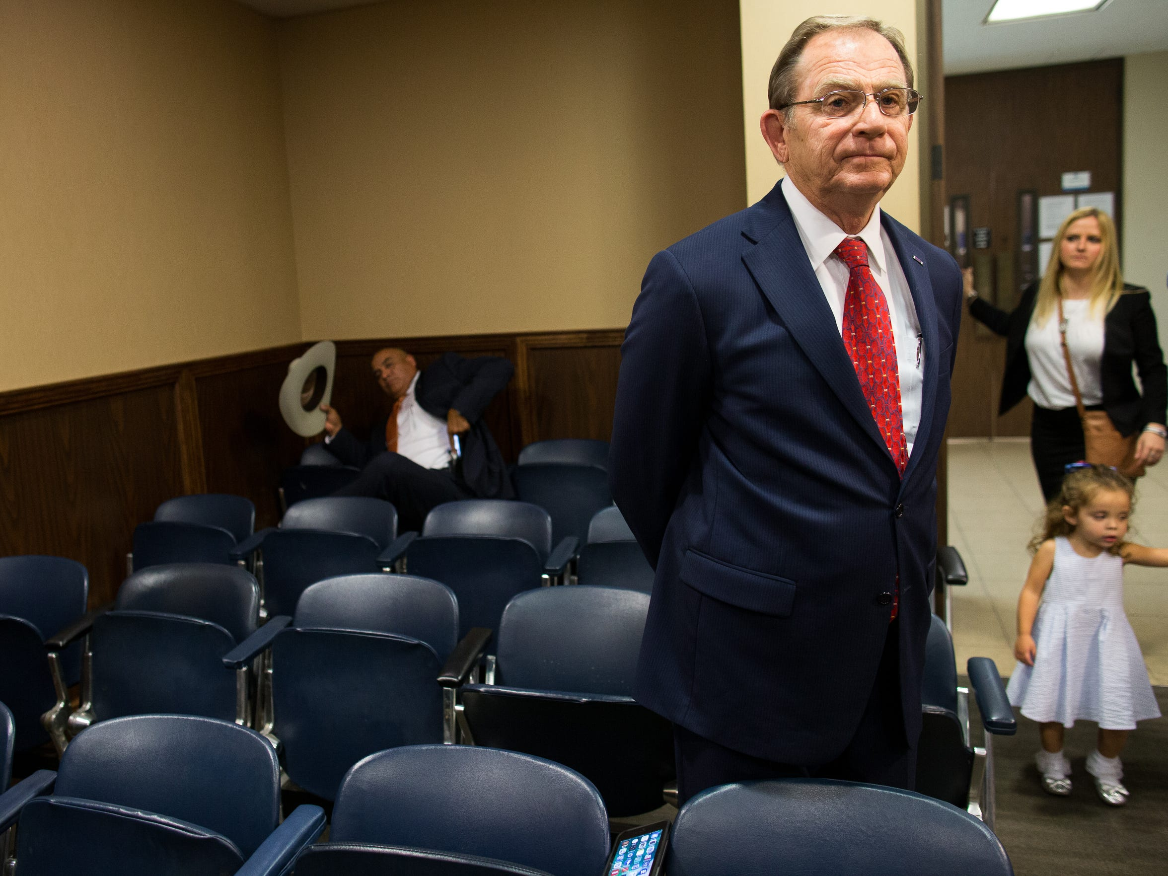 Judge Guy Williams stands in the gallery of the 347th court room before this hearing after being charged with two counts of aggravated assault with a deadly weapon on Friday, Nov. 3, 3017.