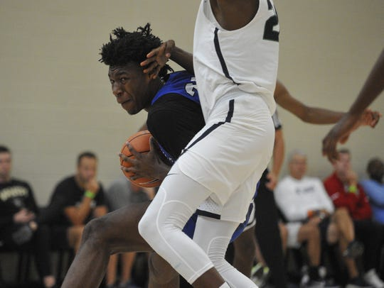 Bluff City Legends' James Wiseman drives against the