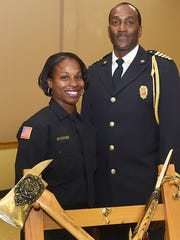 Opelousas Fire Chief Charles Mason is pictured with Shelly Freeman at Friday night's recruit firefighter graduation ceremony held at the Opelousas Civic Center. Freeman is the first female to be installed as a firefighter with the Opelousas Fire Department. See more photos at dailyworld.com and on Facebook.