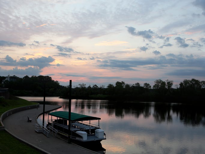 After a couple days of rain, Friday is off to a good start as the sun rises over Winton Lake at Winton Woods Park.