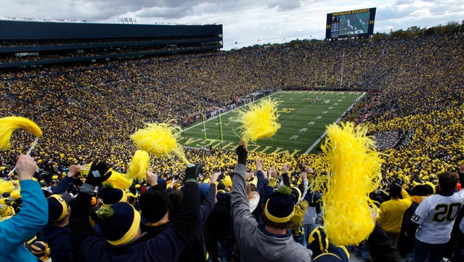 Fans cheer in the Big House during 1st quarter action between Michigan and Michigan State  in Ann Arbor, Saturday, Oct. 17, 2015.