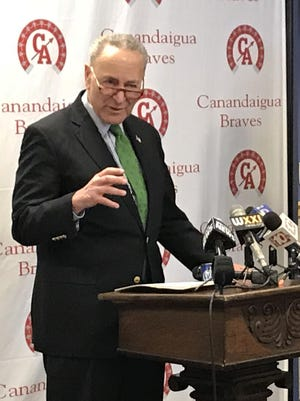 A Greece man pleaded guilty to threatening U.S. Sen. Charles Schumer, pictured here at a press conference in Canandaigua a few years ago.