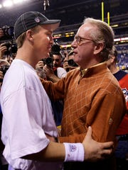 Indianapolis Colts quarterback Peyton Manning, left, shares a moment with his father, Archie Manning, after the Colts defeated the New York Jets, 30-17, in the AFC Championship at Lucas Oil Stadium in Indianapolis, Indiana, Sunday, January 24, 2010. (Mark Cornelison/Lexington Herald-Leader/MCT)